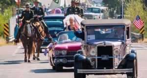 Parade with vintage cars and officers on horseback
