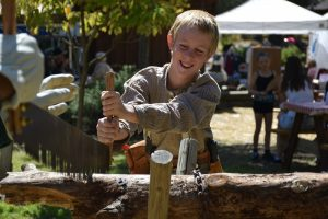 Photo of boy in sawing demonstration