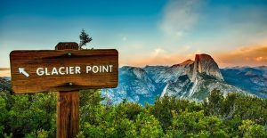 Panoramic of Half Dome mountain in Yosemite with Glacier Point sign