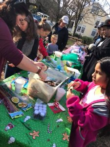 Children make ornaments and crafts at picnic table