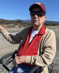 Old Man Waving to Cars