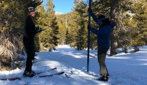 Snow surveyors measure the snow
