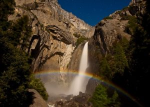 A full moon and spring run-off in Yosemite Falls, creates this lunar rainbow. To the naked eye, it is a shimmering silver arc, but the camera's sensor on a long exposure catches the color. Photo by Douglas Croft