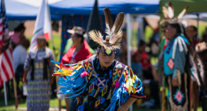 Native American dancer in full regalia performs at past Indian Fair Days in North Fork