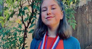 Gold medal winner proudly wears her awards